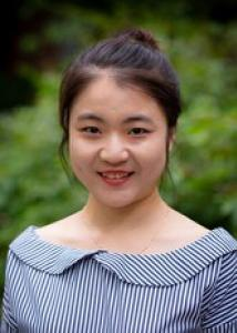 Headshot of Yining Feng with black hair, blue and white striped shirt.